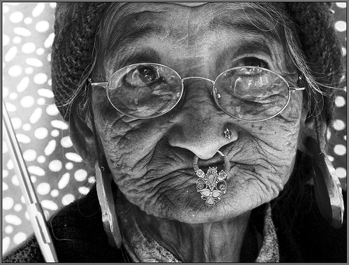 File:An old lady with an umbrella in Ravangla market!.jpg