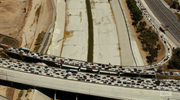 An aerial shot shows us roads completely blocked with cars
