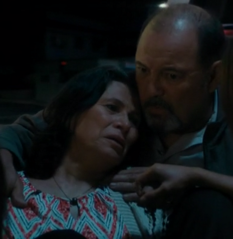 File:Her husband holds her.png