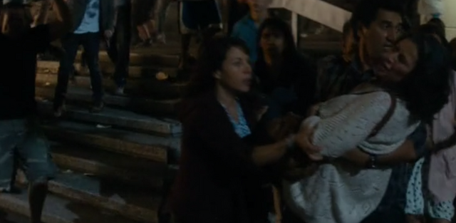 File:Travis picks up Griselda as you would a child.png