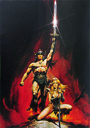 A man, wearing nothing but a loincloth and a horned helm, strides forth, holding a sword aloft in his left hand. A blond woman kneels in front of him, holding a curved blade with both hands.