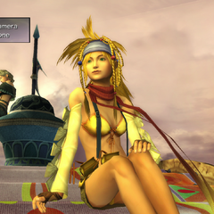 Rikku and Paine during Tobli's show in <i>Final Fantasy X-2</i>.