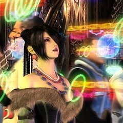 Lulu views a sphere recording of Zanarkand's glory days in <i>Final Fantasy X</i>.