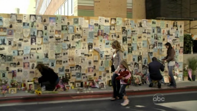 File:Olivia charlie wall.png