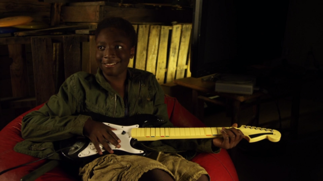 File:Image fred 3 camp fred dig with a guitar.png