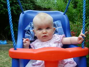 Swinging-in-the-garden-7-seven-month-old-baby-girl