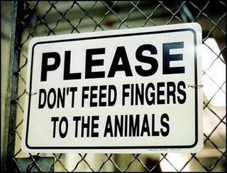File:Dont-feed-fingers-to-animals-1-.jpg