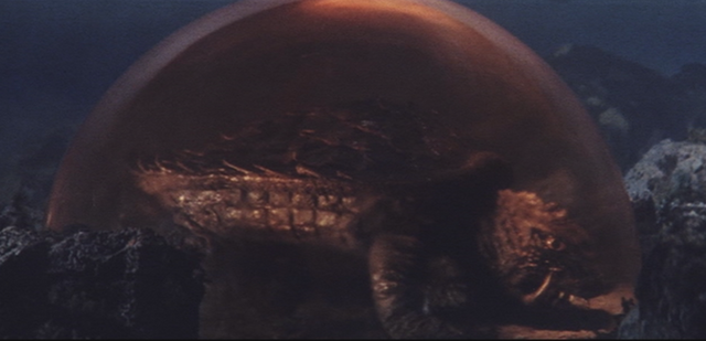 File:Gamera - 4 - vs Viras - 5 - The aliens trap Gamera in a bubble.png