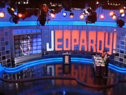 Jeopardy! 1991 set with Trebek photo on game board