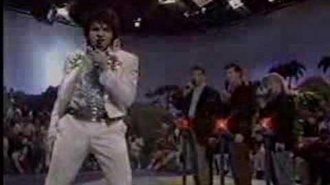 Rockapella's Elliott Kerman as Elvis