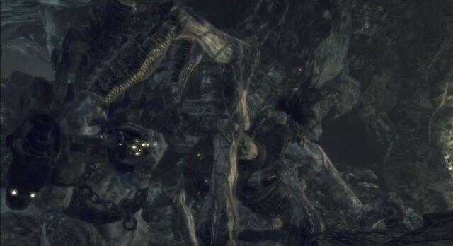 File:Gow2-Brumak-vs-corpser.JPG