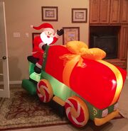 Gemmy Prototype Christmas Santa on Present Tractor Inflatable Airblown