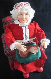 1995 gemmy north pole productions animated mrs santa claus petting her dog figure