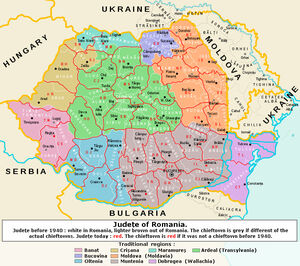 Outline showing the territory of present Romania and its into counties superimposed over the colored map of the inter-war counties.