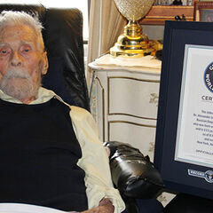 Alexander Imich at age 111 with GWR certificate naming him the World's Oldest Man.