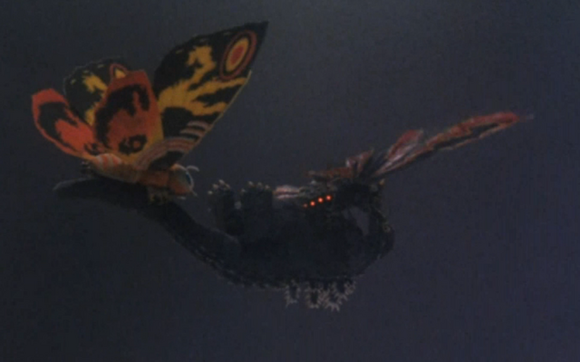 File:Godzilla And Mothra The Battle For Earth - - 1 - Mothra and Battra carry Godzilla away.png
