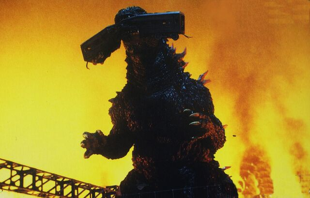File:GXM - Godzilla Chomps On Train.jpg