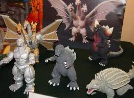 File:UNRELEASED BANDAI FIGURES - Anguirus 1955 and Mecha-King Ghidorah.jpg