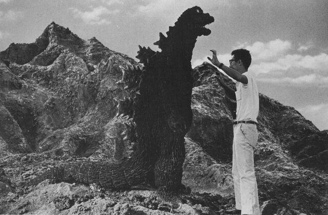 File:Godzilla and a Man Standing on a Mountain.jpg