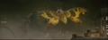Mothra attacks Godzilla with scales