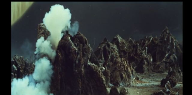 File:Godzilla continues to hide behind a rock.png