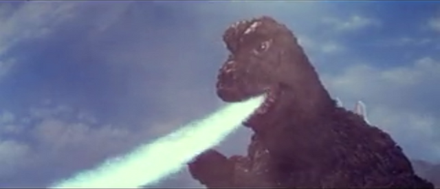 File:MusukoGoji fires atomic breath at Kamacuras.png