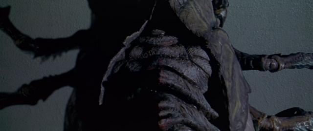 File:Godzilla vs. Megaguirus - Meganulon starts molting.png