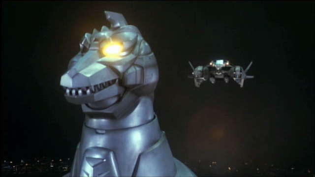 File:MechaGodzilla 2 and the Garuda prepare to link.png