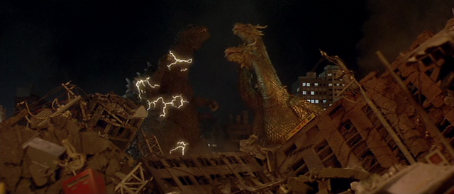 File:GMK - Ghidorah Releases Godzilla.png