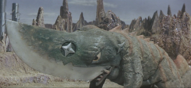 File:Gamera - 5 - vs Guiron - 27 - Guiron gets one of his shurikens in his shoulder.png