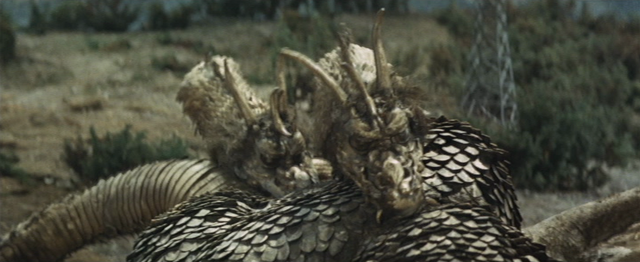 File:IOAM - King Ghidorah is Down After Being Free of Mind Control.png