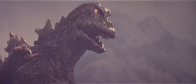 File:All Monsters Attack - DaisensoGoji appears via stock footage.png