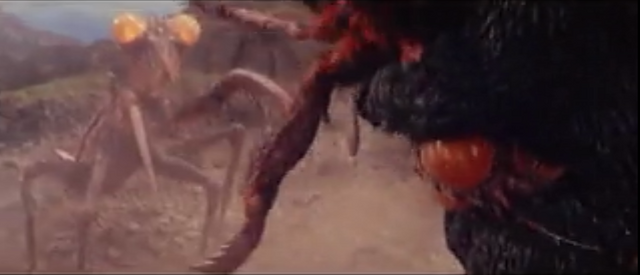 File:All Monsters Attack - Kamacuras number 2 gets beat up in front of Kamacuras number 3.png