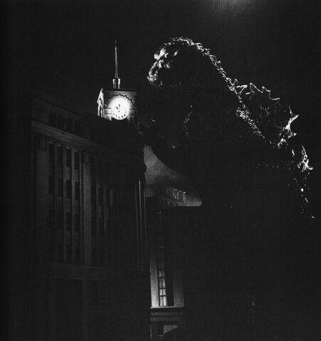 File:G54 - Godzilla Aproaches Clock Tower.jpg