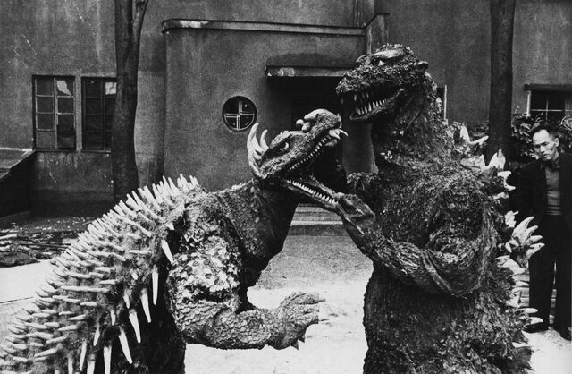 File:GRA - Man Sees Godzilla Holding Anguirus by the Jaw.jpg