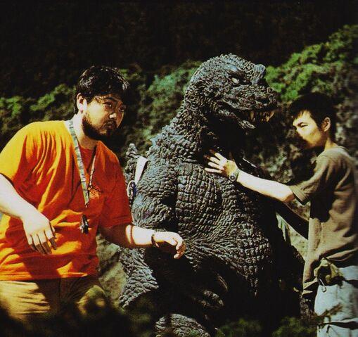 File:GMK - Godzilla and Two Men.jpg
