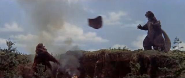 File:King Kong vs. Godzilla - 41 - King Kong Throws A Rock While Godzilla Dances.png