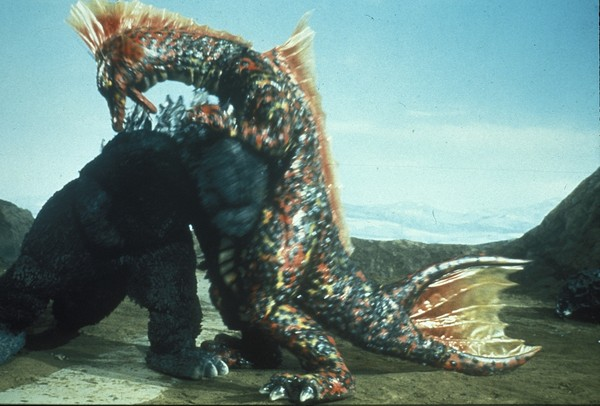 File:TOMG - Godzilla Headsmacks Titanosaurus.jpg