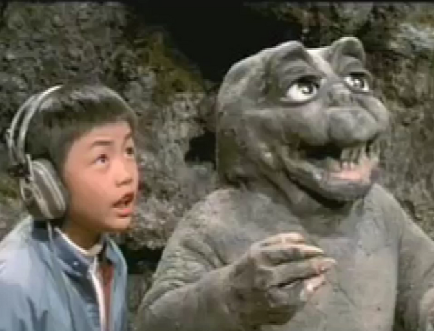 File:All Monsters Attack 1 - Minilla and the kid.png