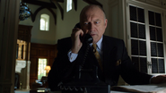 Carmine Falcone talking on the phone