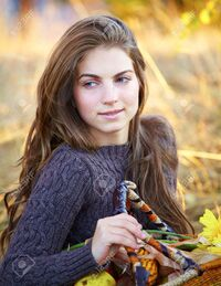 11929577-Portrait-of-a-beautiful-20-year-old-young-woman-outdoor-during-autumn-season--Stock-Photo