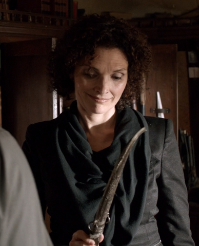 File:201-Kelly Burkhardt with castration blade.png