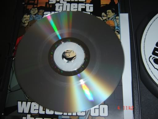 File:ScratchedCD-Rom-GTA3.jpg