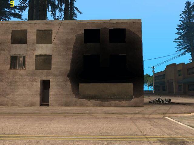 File:Torched building.jpg