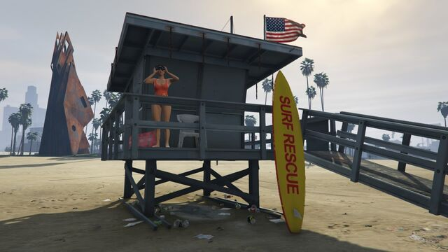 File:Lifeguard GTAVe Vespucci Watchtower with Surfboard.jpg