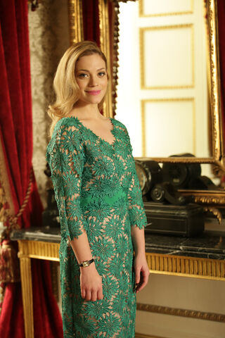 File:Charlotte's elegant green dress with intricate embroidery.jpg