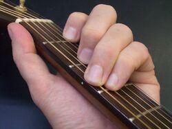 Frets, guitar neck, C-major chord