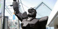 A bronze statue of Gundam