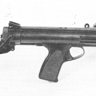 The BSA Machine Carbine Mk.II, with a modified cocking sleeve and 30-round curved magazine.