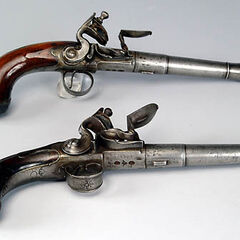 Two flintlock pistols.